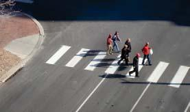As pedestrian presence increases, and to mark the downtown core as a pedestrian space, special emphasis markings such as longitudinal ladder style crosswalks should be used to increase visibility and