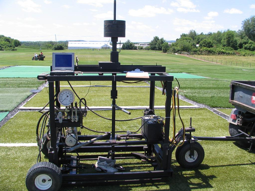 Figure 13. Pennfoot traction testing device. foot raised off the ground. For each measurement, the shoe was rotated 45 degrees. Pennfoot was repositioned on the playing surface between trials.