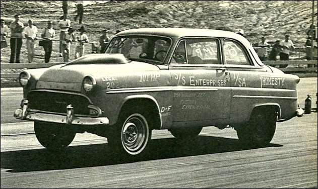 ABOVE - Hunching low in the saddle, Ike Smith urges his Hudson Jet, replete with Ford hood scoop, on toward another record in the lower stock classes. '54 camshaft that provides.