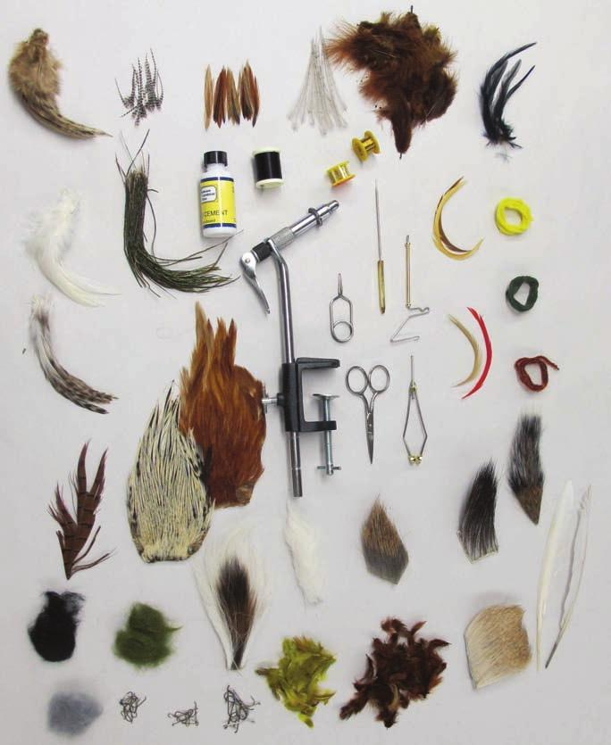 fur, 4 colors of hack le, marabou, 3 colors of dubbing, bucktail, squirrel tail, calftail, mallard flank, duck quill, gold wir e, tinsel, hook assortment, 3 types of dry fly genetic hackle, 2