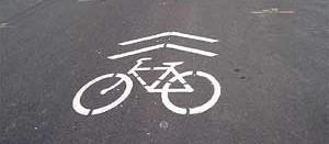 Shared lane markings may only be used on streets with speed limits of 35 mph or lower. Figure 2.8. Shared Lane Marking.