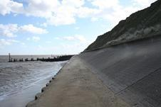 Hard engineering solutions Type of defence Pros and cons Building a sea wall A wall built on the edge of the coastline Advantages Protects the base of cliffs, land and buildings against erosion.