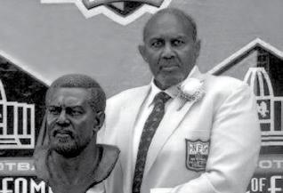 FORMER NFL GREATS Bob Brown (right) became Nebraska s third inductee in the Pro Football Hall of Fame in August of 2004, joining Guy
