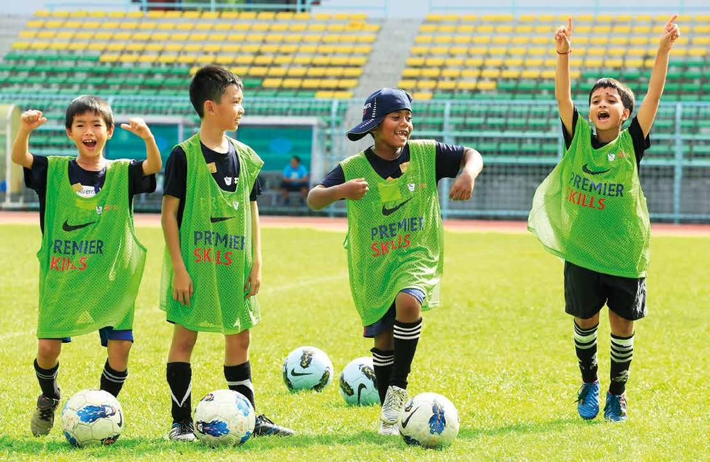 From Malaysia to Merseyside Below: Children enjoying Premier Skills coaching in Malaysia Kelvin s story Premier Skills is our flagship international initiative, which is part of a long-standing
