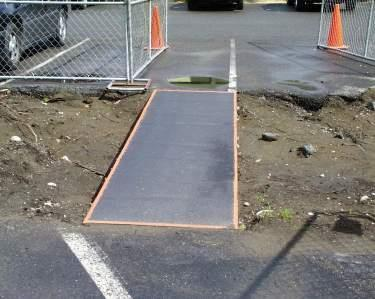 Skid-resistant coating on ramp.