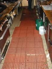Skid-resistant, anti-fatigue mats in kitchen