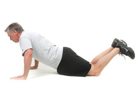 Push Up on Knees Start: On your knees and hands
