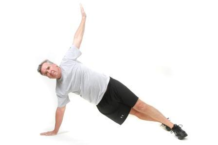 T Push Up Start: On your toes and one hand placed a bit wider than shoulder width and