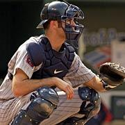 in a relaxed stance (right) Joe Mauer in a relaxed stance (below) READY STANCE (RUNNERS ON BASE/2 STRIKE COUNT) Feet slightly wider than receiving stance heels are on the ground, toes slightly