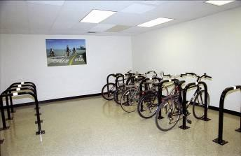Expand efforts to encourage bike parking inside large commercial