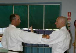 Tori punches with his right hand. Uke blocks shuto and quickly steps in striking shuto.
