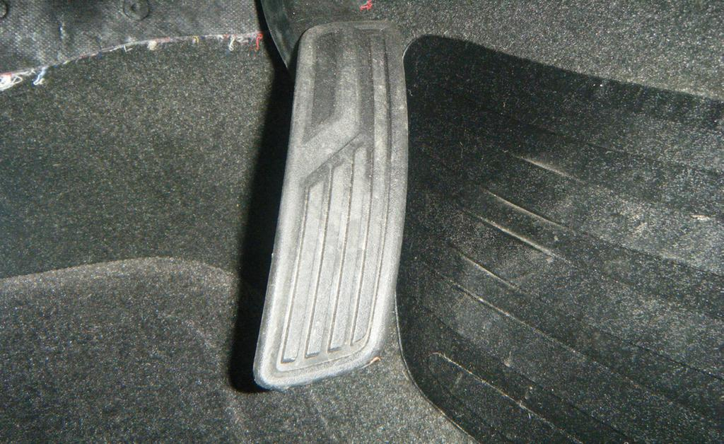 Line up the pedal cover on the brake pedal and, using a center punch, mark the location of the three (3) holes indicated on