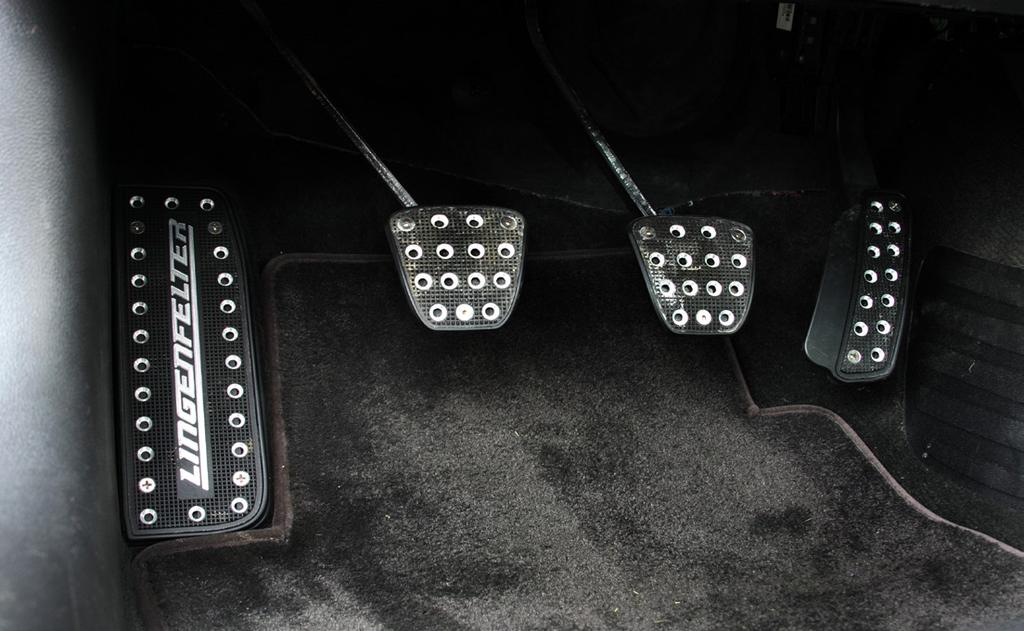 12. If your vehicle has a parking brake pedal, install the parking brake pedal cover.