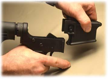 6) Then slide the Magazine Well of your choice down onto the Lower Receiver while again pushing in on the Magazine Catch Bu on.