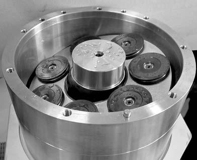 19. Place pistons in retainer plate and cylinder barrel.
