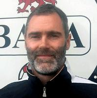 Holds the club scoring record at TNS and was the longest- serving player, a survivor of the 2000 title winning side who played in all three of