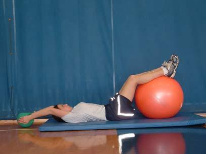 Half Fold with Ball Lie on your back and place your calves on the ball so that your knees are bent to about 110 degrees.