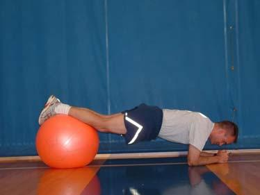 Ab Plank with Unilateral Hip Extension Lie on your stomach on the ball. Walk forward on your hands so that your ankles are on the center of the ball.