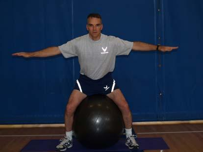 The Ball Squeeze This exercise will strengthen your inner thighs Start in a neutral seated posture with your legs straddling the ball. Hold your hands out to the side for added balance.