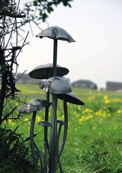 WALKING IN COUNTY DURHAM A peculiar mushroom sculpture stands halfway round the short walk at Ouston and Urpeth and continue along the foot of a wooded slope. The path eventually climbs up to a stile.