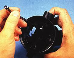 It will be necessary to hold the piston with the tip of your index finger to keep it from rotating.