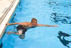 3. Extend your arms in front of you, in the direction you intend to go. 4. Push off the bottom or kick your legs to help move your body into a horizontal position, and then start swimming.