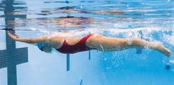 Breaststroke Turn 1. Time your last stroke so that your body is fully stretched as you reach the wall (Fig. 7-15A). 2.