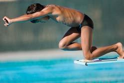 2. Extend your arms overhead with your upper arms pressing together against your ears. 3. Focus on a target on the surface of the water about 4 feet from the end of the springboard. 4. Reach toward the water, dropping your hands and head.
