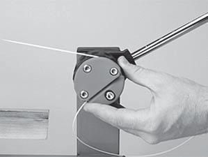 Pulling Tension Wrap the free string clockwise around the gripper drum once and position between the gripper jaw.