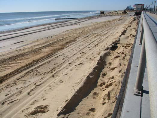 By October 25, 2011, the ACOE project had restored a dry berm seaward of the rock revetment covering the previously exposed rocks.