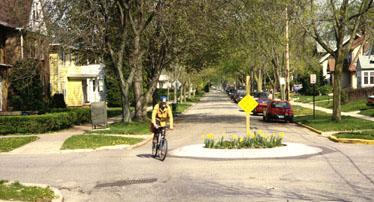 Policy 1: Design new and existing local streets that provide for traffic movement, while ensuring a safe and attractive pedestrian- and bicycle-friendly neighborhood environment.