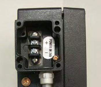 Power Connection: Remove the front cover of the junction box located on left side of the transmitters by removing the four (4) screws securing the cover and set them aside for reinstallation.