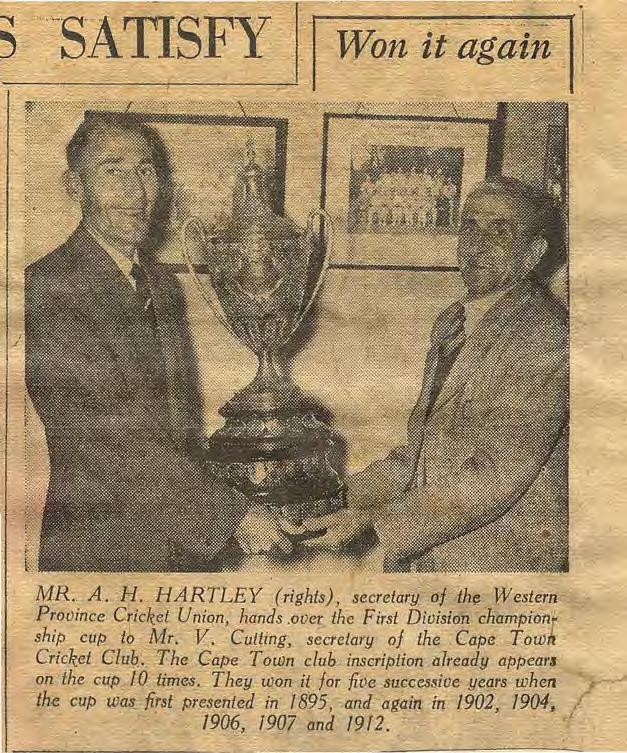 -SATSFY. q MR.._A.. H. H/iRTLEY Jrights), secretary f th~ Western Prvince Cricket Unin, hands.0vet. the First Diisien cnampiflf ship cup t Mr. V.Culling, secretary f the. Cape Twll Cricket.