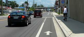At this width, three travel lanes and bicycle lanes are maintained, while the streetside has been reduced to 8.5 feet in width.