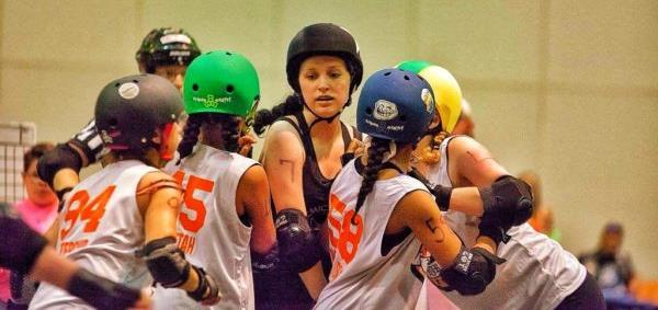 blockers to remove them from her path. There are constant collisions whether it be the jammer pushing through or her blocker hitting an opposing blocker out to help her through.
