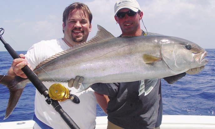 Handle Penn CEO on the water testing the new TRQ300, easily handling a quality amberjack.