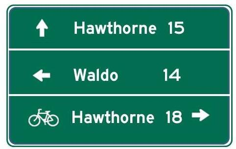 having one of the lines on a multi-line destination sign be bike-specific, or by including both a general traffic route shield, such as a U.S.