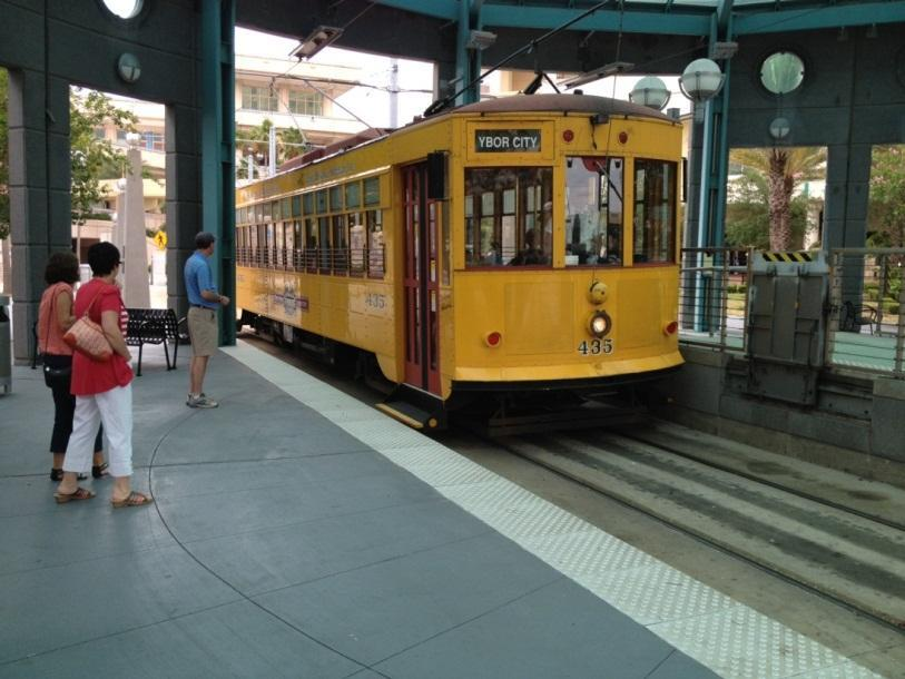Tampa Streetcar arriving at station shelter (Credit: Kimley-Horn and Associates, Inc.) The potential for each configuration is influenced by the street type.