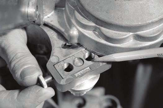 The Second Seam Roller (left side of sealer head) Rotate the crank until a 2 appears in the indicating window.