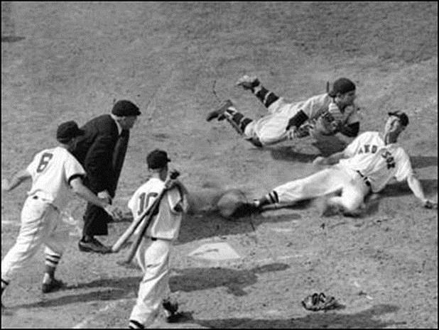 """ Yogi Berra tags the sliding Philadelphia Phillies shortstop Granny Hamner for an out at home plate during the 4 th inning in the final World Series game at Yankee Stadium, October 7, 1950."