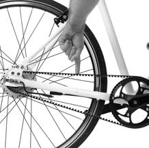 Carefully turn your ebike upright (the rear wheel will not be fully secure) and locate the tension marker on the frame