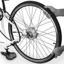 Attaching the rear wheel Place the frame upside down on a flat surface, resting on the saddle and the