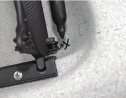 Leave the screw a little loose so that you can run the steering line underneath the screw head.