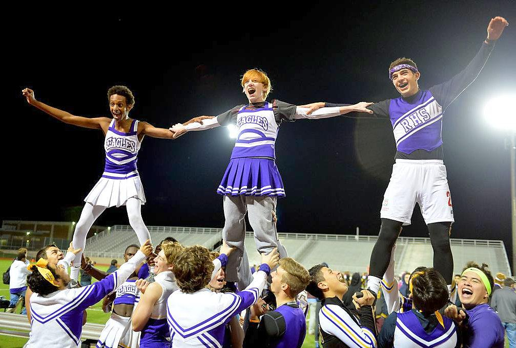 During the second half of the annual Powder Puff Football game, sophomore Jack Macy, senior Jesus Casiamano and junior Nathan Abraham fly above the rest of the cheer squad as they cheer on the