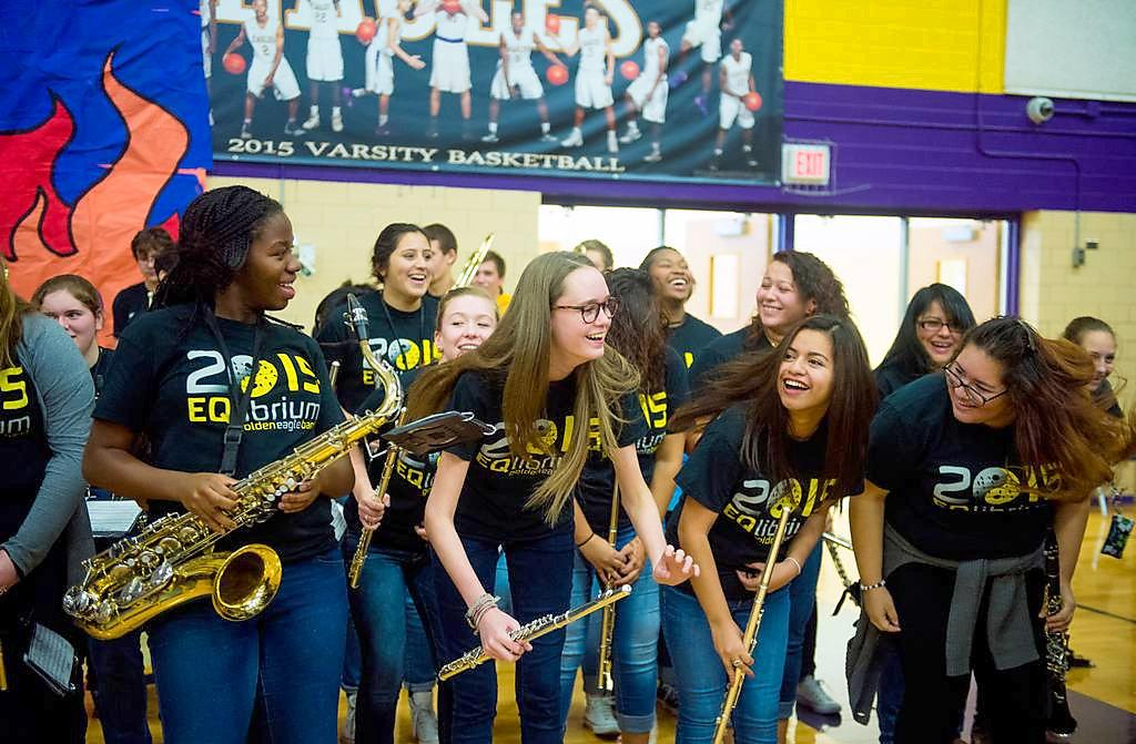 Leaning forward as they dance to the tuba call during the magnet pep rally, sophomore Sydney Ogaga, junior Emma Kilgore and seniors Joseline Hernandez and Ambar Sanchez smile at each other.