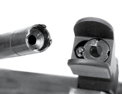Rear Sight SIGHTS 1. The YHM rear sight can be adjusted for windage and has a dual aperture peep, one for close range and one for long range. windage knob 2.