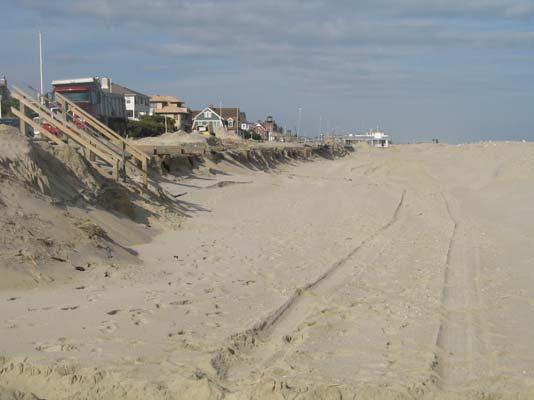 Sand was being carted back the beach as a sizable ridge. The berm was reduced in both width and elevation in dramatic fashion.