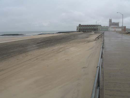 The smaller structures showing on the left photograph are missing after sandy, but the boardwalk had minor damage as waves forced sand under and upward raising decking in