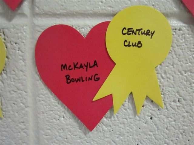 5) Century Club hearts are red with a yellow ribbon. Century Club hearts go on the Heart Wall display just past the participation hearts.