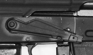 ) NOTE: When the safety lever is in its lower position on the receiver, the gun is in the FIRE position. (See Illustration #3.